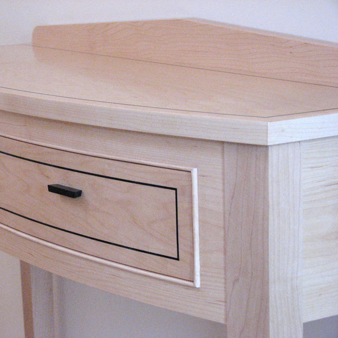 Maple console table with ebony inlay.