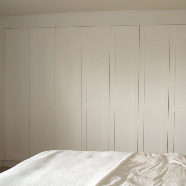 Bank of fitted bedroom wardrobes