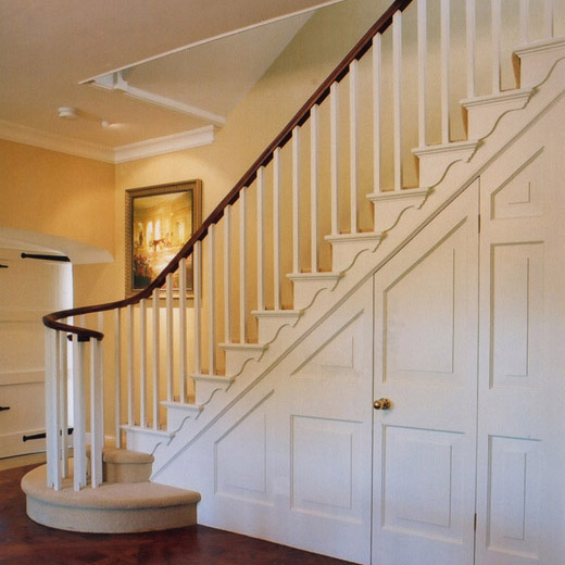 Painted staircase with curving bannister